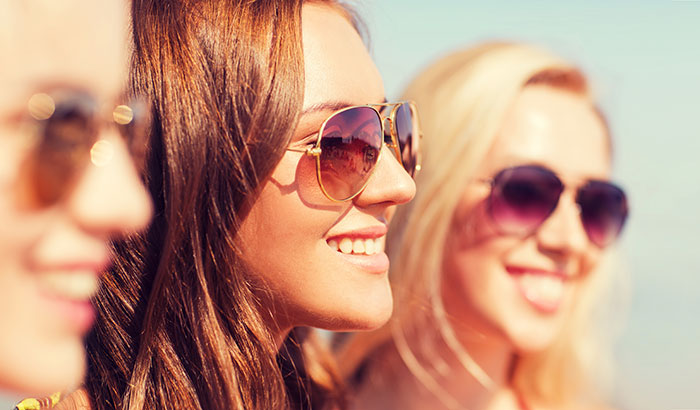 group of young women wearing sunglasses